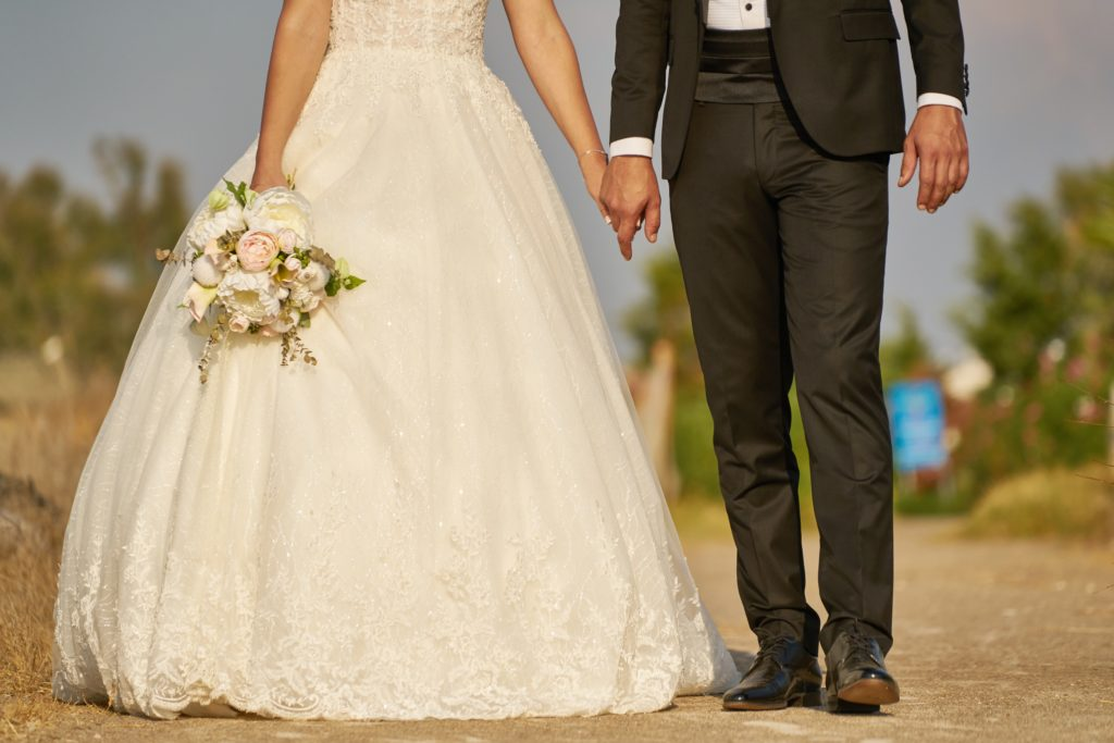 woman-wearing-white-wedding-dress-and-man-wearing-black-suit-2946812