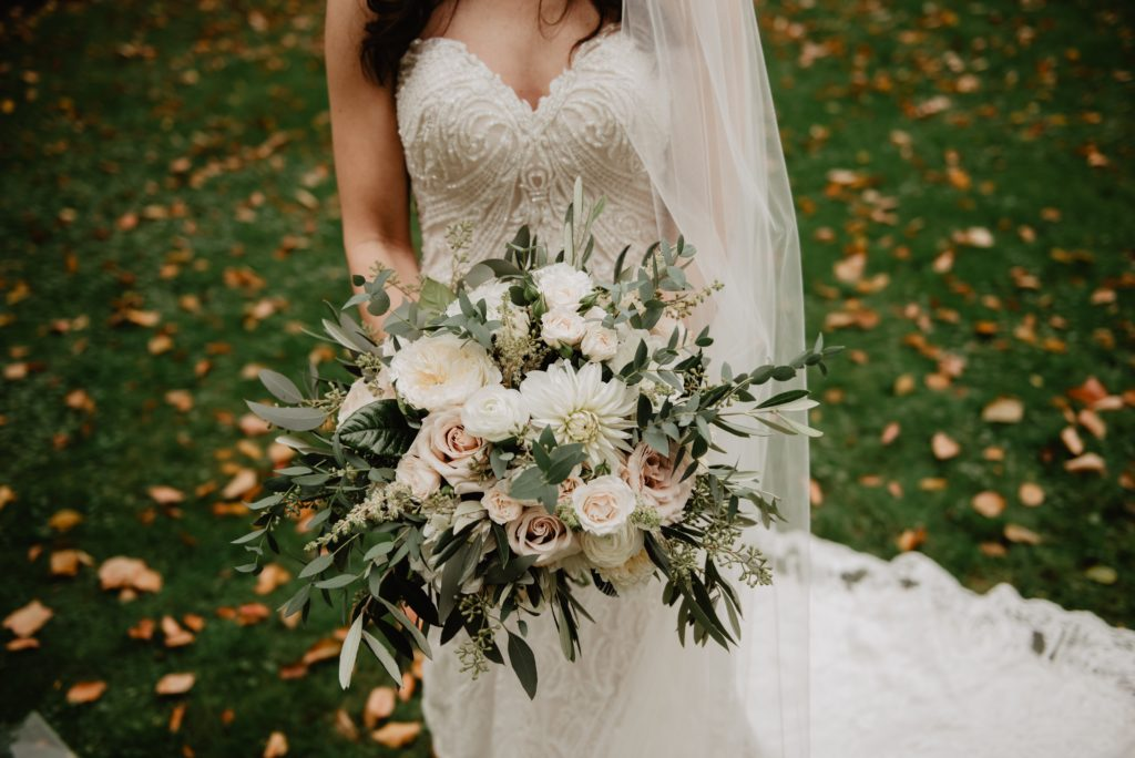 woman-wearing-white-wedding-dress-with-bouquet-of-flowers-2253866