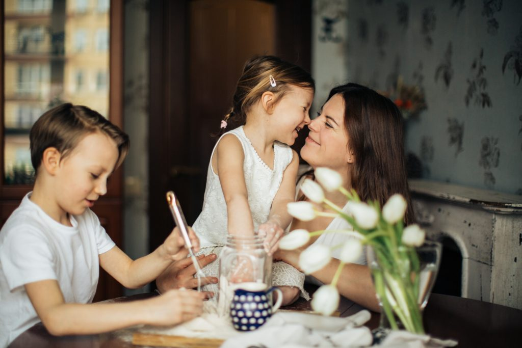 photo-of-woman-playing-with-her-children-3806953
