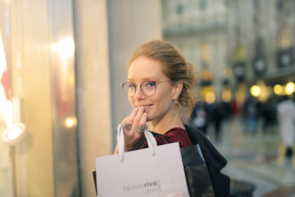 woman-holding-shopping-bag-selective-focus-photography-1004877