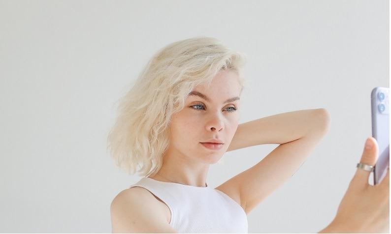 photo-of-girl-in-white-top-taking-selfie-using-smartphone-4723518
