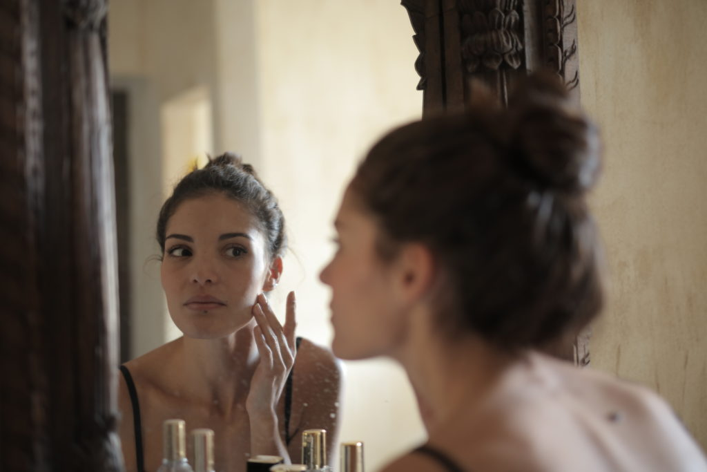 reflection-photo-of-woman-touching-her-cheek-3785806